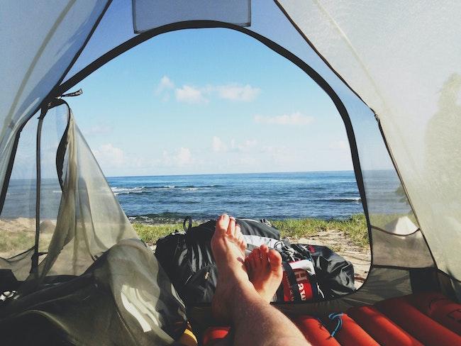 Man in a tent by the beach on the Best Air Mattress, Australia (2020)