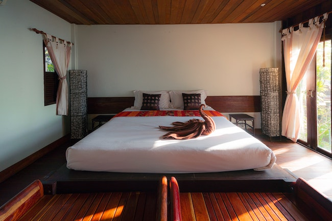 Master bedroom with a folded swan towel and the Best Pocket Spring Mattress, Australia (2020)